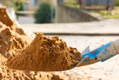 Spade. Closeup of a shovel full of building sand Royalty Free Stock Image