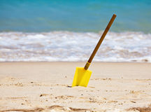 Spade on a beach Royalty Free Stock Photography
