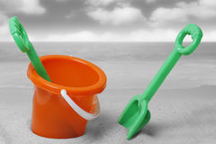 Spade and bucket on  beach Stock Image