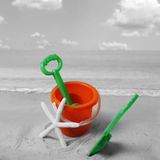 Spade and bucket on  beach Royalty Free Stock Photos