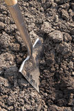 A spade digging the soil Royalty Free Stock Photography