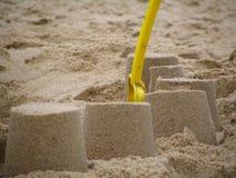 Spade en zandkastelen Stock Fotografie