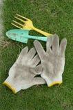 Spade gloves and rake with Garden. Green spade,cotton gloves and yellow cake with Garden Royalty Free Stock Photo