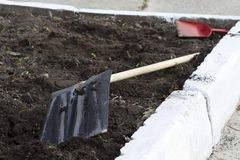 Spade on the lawn. Shovel resting from work, closeup Royalty Free Stock Photos