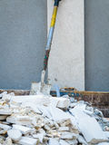 Spade in pile of rubble. Royalty Free Stock Photos