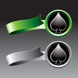 Spade playing card suit on green and gray ribbons. Gray and green ribbons with a black spade icon Stock Images