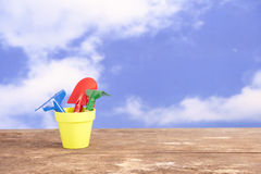 Spade and rake in yellow flower pot Royalty Free Stock Photos