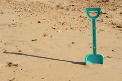 Spade in sand Royalty Free Stock Photography