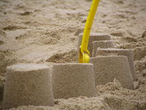 Spade and sand castles stock photography