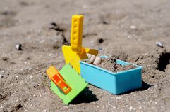 Spade set on a beach. With a shell royalty free stock photo