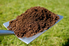 Spade with soil. Royalty Free Stock Images
