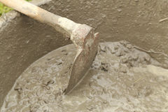 Spade and wet cement for construction Stock Images