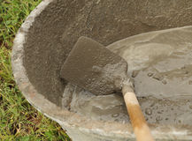 Spade and wet cement Stock Image