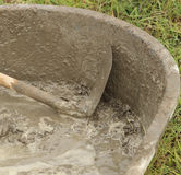 Spade and wet cement Royalty Free Stock Photography