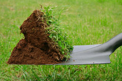 Spadeful of dirt Stock Photography