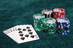 Spades and Chips. A royal flush of spades and a pile of chips royalty free stock photography
