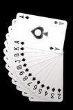 Spades on row. All spades on row ,isolated on black background Royalty Free Stock Photography
