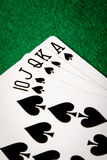 Spades straight flush. Poker cards on green table Royalty Free Stock Photography