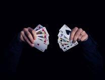 Spades vs hearts. Caucasian hands holding royal flush combination of hearts and spades Royalty Free Stock Photos