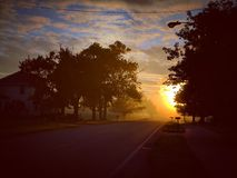 Spadku wschód słońca iluminuje żniwo nagrodę obraz stock