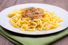 Spaetzle with fried onion Stock Photography