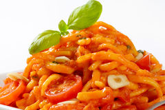 Spaetzle in garlic tomato sauce Stock Photos