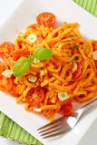 Spaetzle in garlic tomato sauce Royalty Free Stock Photo