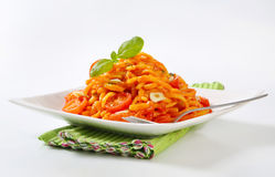 Spaetzle in garlic tomato sauce Royalty Free Stock Images