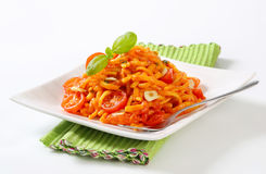 Spaetzle in garlic tomato sauce Stock Photo