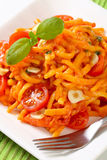 Spaetzle in garlic tomato sauce Royalty Free Stock Image