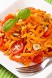Spaetzle in garlic tomato sauce Royalty Free Stock Image