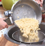 Spaetzle Are Poured Stock Photography