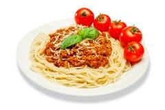 Spagetti bolognese på en vit platta royaltyfria bilder