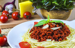 Spagetti bolognese. With vegetables on wooden table Stock Photos