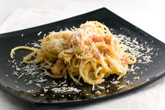 Spagetti carbonara. On a black plate Royalty Free Stock Photo