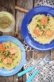 Spagetti con los salmones Fotos de archivo