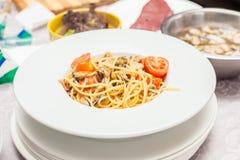 Spagetti med skaldjur och tomaten Royaltyfri Bild