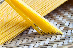 Spagetti. Uncooked spagetti in basket , focus on center Stock Images