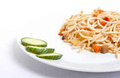 Spagetti with vegetables on the white plate Stock Photography