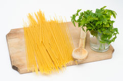 Spaghetti on wood board with wood spoon Stock Photography