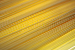 Spaghetti 1. Strands of spaghetti lit from blow form a banded surface Royalty Free Stock Photo