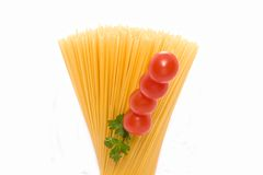 Spaghetti. With red tomatoes with a white background Royalty Free Stock Images