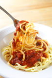 Spaghetti. With sauce on the dish Stock Images