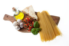 Spaghetti. Arrangement of the basic ingredients for the real italian spaghetti Stock Photos
