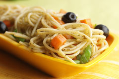 Spaghetti. Cooked Spaghetti  garnished with vegetables Royalty Free Stock Photos