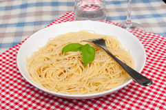 Spaghetti. With Basil Served on Red Gingham Tablecloth Stock Image
