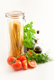 Spaghetti. And ingredients for italian meal Royalty Free Stock Images