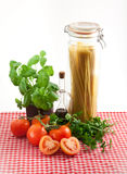 Spaghetti. And ingredients for an italian meal Royalty Free Stock Photo