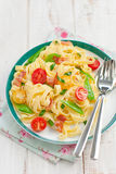Spaghetti. With tomatoes, a siliculose string bean and bacon Stock Photography