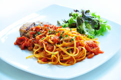 Spaghetti. The scrumptious spaghetti with tomato saurce and good decoration Stock Images